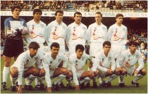 Formación 1991-92. Arriba: Conejo, Zalazar, Juárez, Antonio, Coco, Geli. Agachados: Urzaiz, Menéndez, Catali, Chesa, Oliete.
