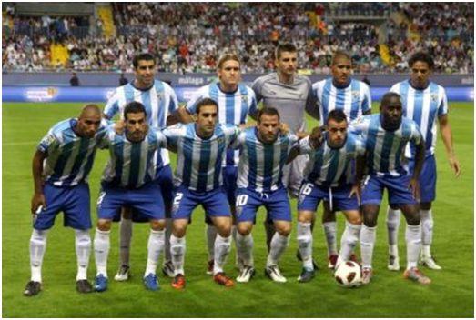 Formación 2010-11: Arriba: Juanito, Kris, Galatto, Rondón, Weligton. Agachados: Mtiliga, Fernando, Jesús Gámez, Apoño, Edu Ramos, Quincy.